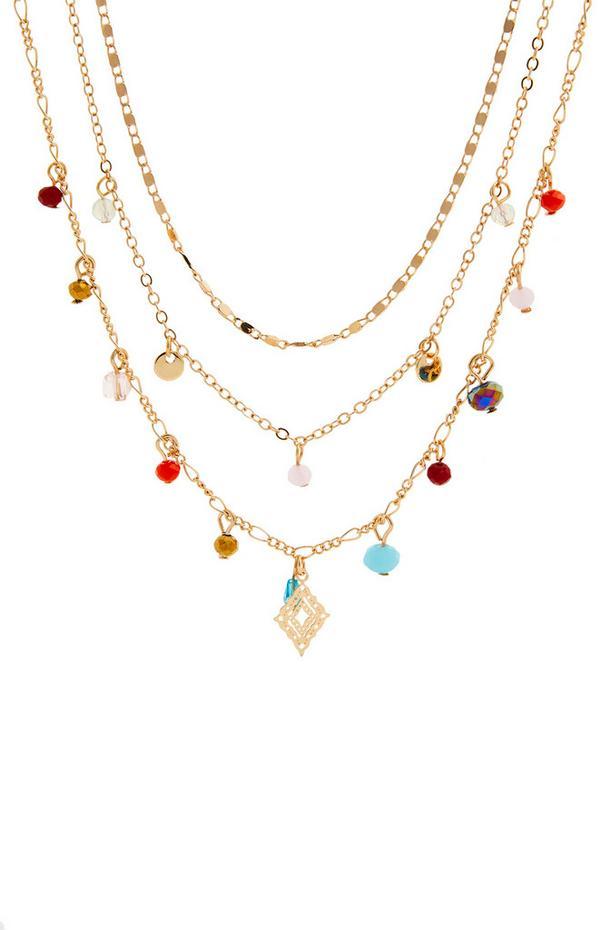 Collana color oro a più fili con perline e ciondoli delicati