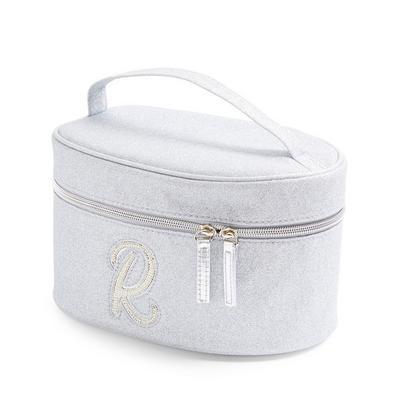 Trousse de toilette argentée et cloutée à paillettes avec initiale R en fausses perles