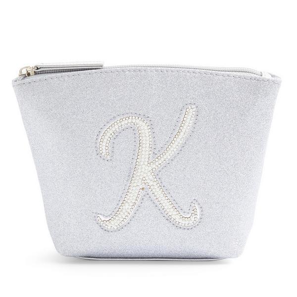 Zilverkleurige minitoilettas met glitters, letter K