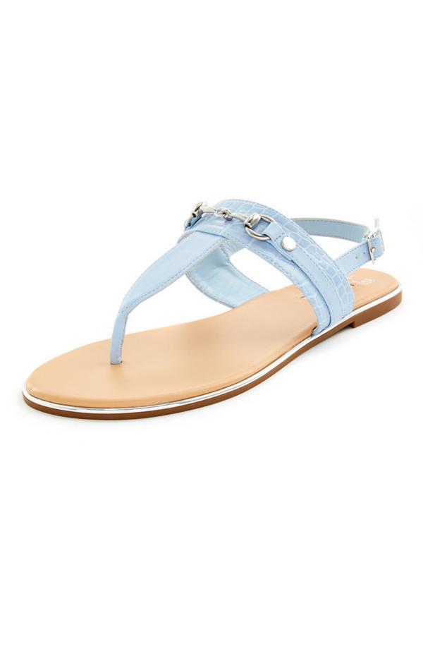 Blauwe platte sandalen met goudkleurige accenten
