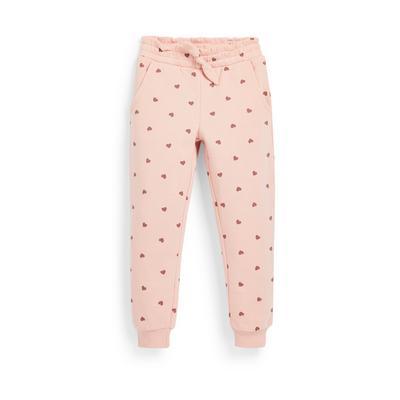 Pantalon de jogging rose à imprimé cœurs fille