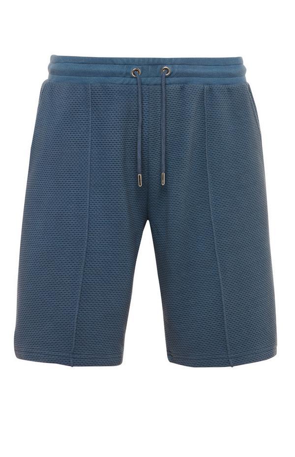 Donkerblauwe short Kem met wafelstructuur en trekkoord in taille