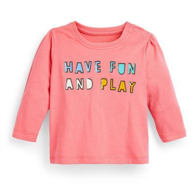 T-shirt rose à manches longues et message bébé fille
