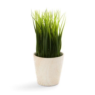 Kunstpflanze mit weißem Blumentopf aus Holz
