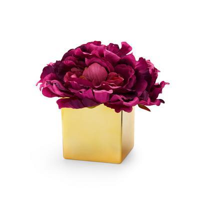Goldfarbener Topf mit Kunstblumen