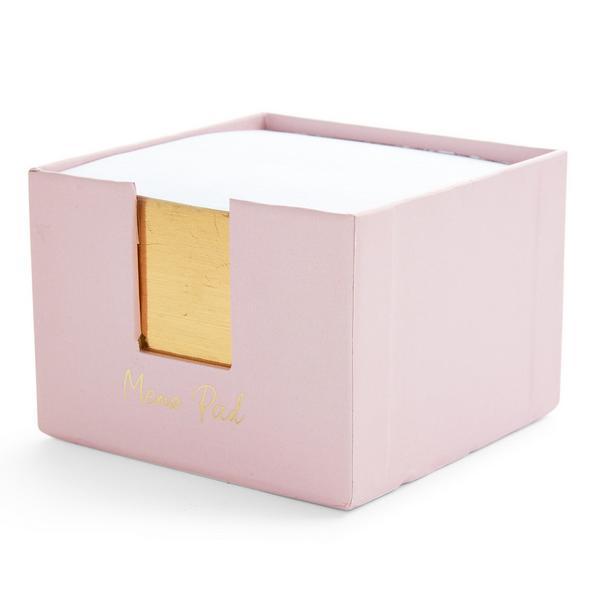 Bloque rosa de notas adhesivas